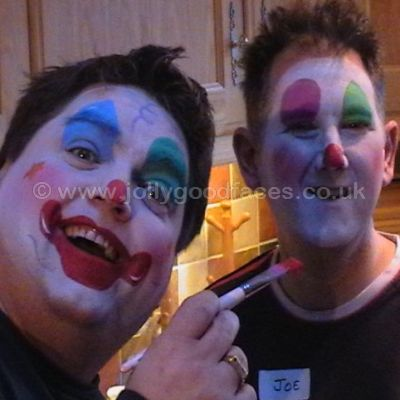 These men are having fun learning to face paint